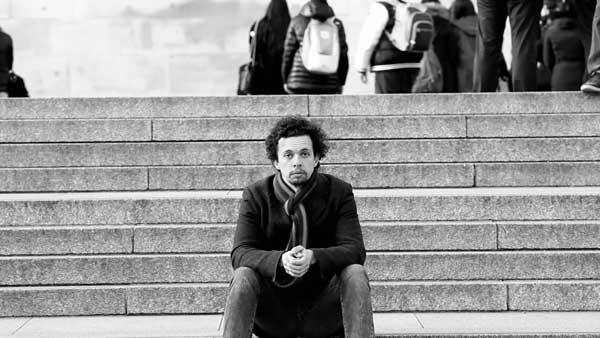 Comedian sitting on steps in Trafalgar Square